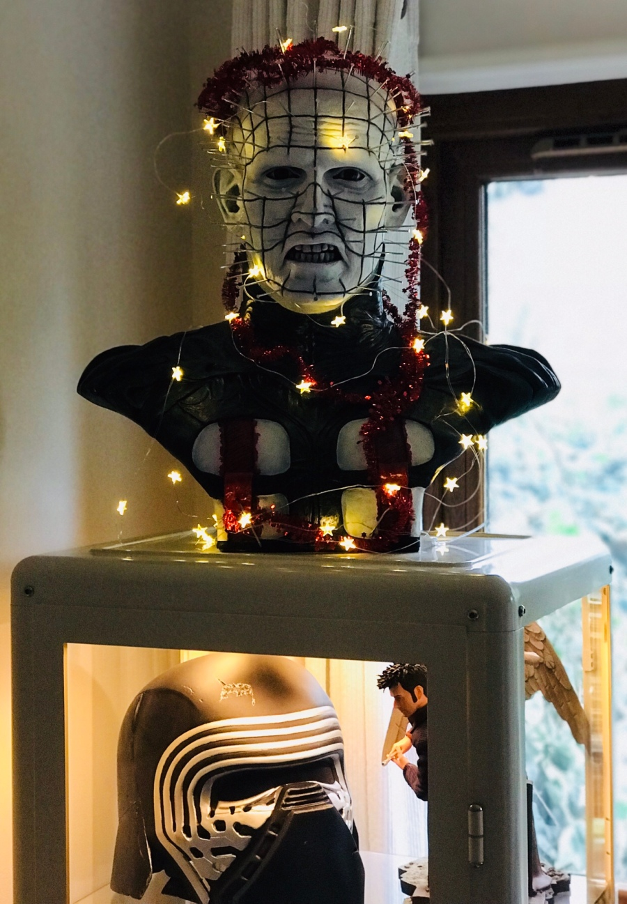 Pinhead looking happy with Christmas. Careful or he will tear your soul apart (and I don't mean you're shoes!)
